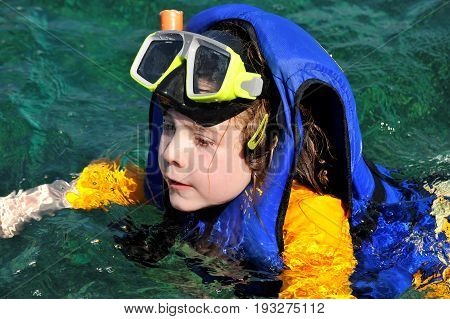Child Girl Swiming In The Sea
