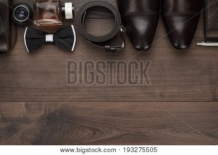 men's accessories in order. classic men's accessories on the brown table. stylish men's accessories on the wooden background. men's accessories overhead view. men's accessories with copy space