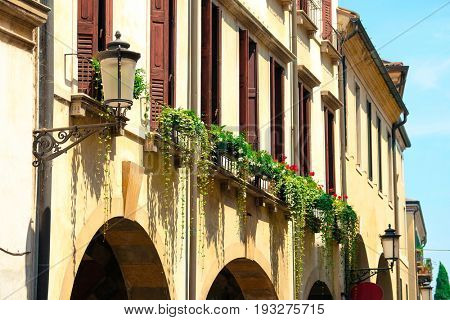 Flower-pot on the windows of inhabitable house in Padova, Italy