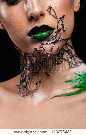 Neck details of creative fashion make up on black background in studio photo. Cosmetics and extravagant makeup