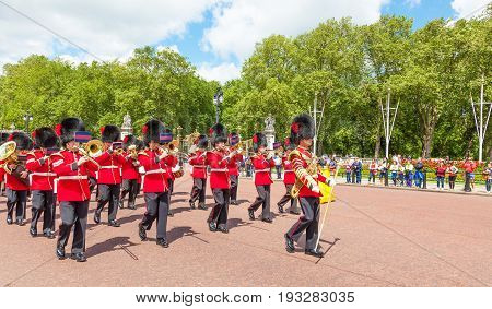 LONDON UNITED KINGDOM - JULY 11 2012: The band of the Coldstream Guards marches down The Mall at the completion of the Changing of the Guard ceremony.
