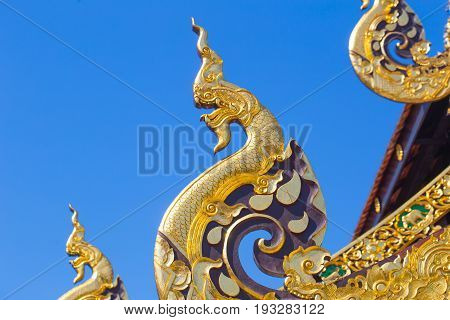 Beautiful Golden Thai Lanna Architecture: Naga Wood Carved At Chapel Roof Of Wat Inthakhin Sadue Mua