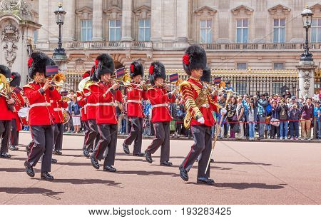 LONDON UNITED KINGDOM - JULY 11 2012: The band of the Coldstream Guards marches in front of Buckingham Palace during the Changing of the Guard ceremony.