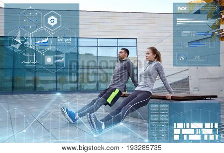 fitness, sport and people concept - couple doing triceps dip exercise on bench outdoors