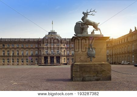 Deer sculpture with crest in front of the main entrance of the New Castle (Neues Schloss) in Germany Stuttgart