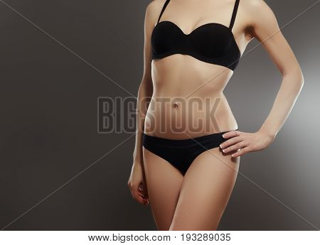 Muscular Woman's Body In Lingerie Isolated On White Background
