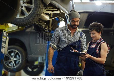 Car service staff reading application of client