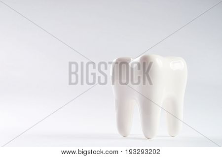 White healthy Tooth isolated on white background with copy space. Oral dental hygiene. Teeth Whitening. Dental health Concept. Oral Care teeth restoration. Yellow and white teeth.