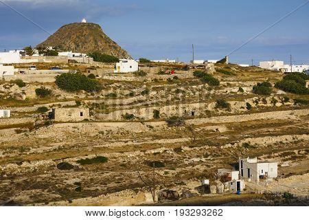 Triovasalos village and castle hill on Milos island in Greece.