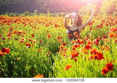 Selfie Photo By Mobile Phone Of Girl In Poppy Field