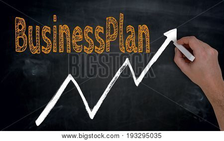 Businessplan And Graph Is Written By Hand On Blackboard