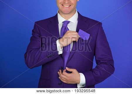 Man With Hands Putting Blank Bank Or Business Card In Pocket