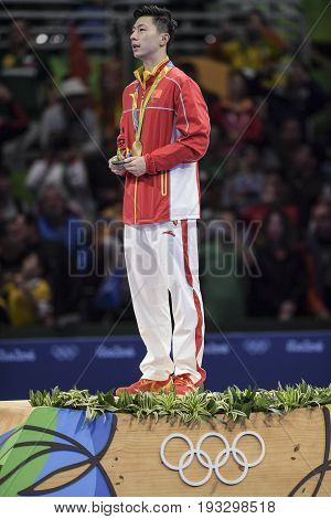 Rio Brazil 11 august 2016: Ma Long (CHN) gold medal in the table tennis of the Olympic Games rio2016 on the podium