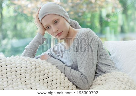 Young sad woman worrying about her health condition