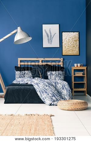 Bedroom withe blue wall and wooden furniture