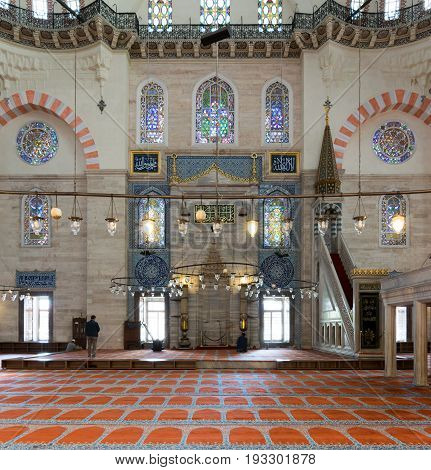 Istanbul Turkey - April 19 2017: Few people praying at Suleymaniye Mosque an Ottoman imperial mosque built in 1557 located on the Third Hill of Istanbul Turkey and the second largest mosque in the city