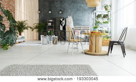 Simple minimalist dining space in stylish industrial loft