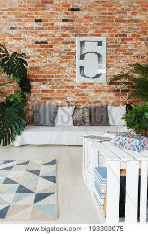 Stylish original decorated room with brick wall