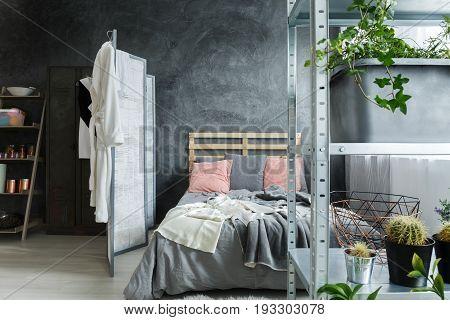 Cozy contemporary bedroom in fancy industrial loft