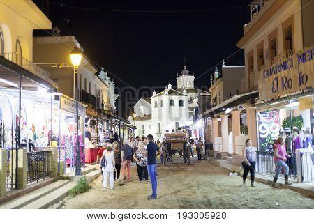 El Rocio Spain - June 1 2017: Street scenery in El Rocio at night during the Romeria 2017. Province of Huelva Andalusia Spain