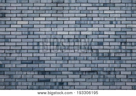 Stone texture background of grey brick wall texture with stone grey bricks. Brick wall -texture stone background with stone bricks. Texture brick surface. Brick stone wall, texture background. Texture stone surface background
