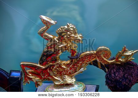 Close up of the mermaid ornament of a gondola.