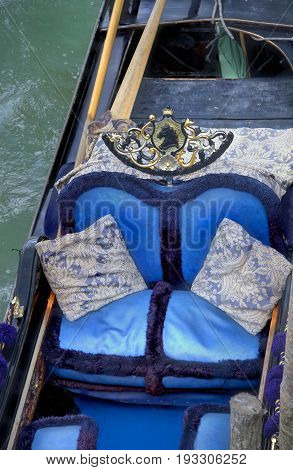 Close up of a blue and silver seat in a gondola.