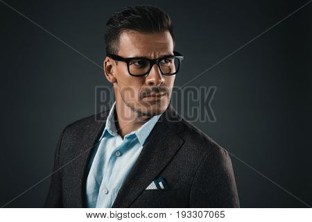 Portrait Of Confident Stylish Man In Eyeglasses Looking Away Isolated On Grey