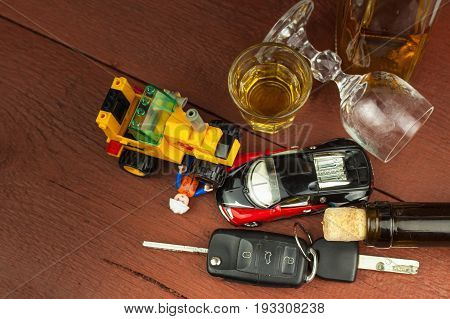 BRNO CZECH REPUBLIC -29 JUNE 2017: Concept of alcohol-related traffic accident. Car models car keys and alcohol. Dangerous on the road. Illustration photo.