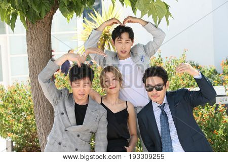 Kim Hee-won, Hye-Jin Jeon, Yim Si-wan and Kyoung-gu Sul attends the 'The Merciless' photocall during the 70th annual Cannes Film Festival at Palais on May 25, 2017 in Cannes, France.