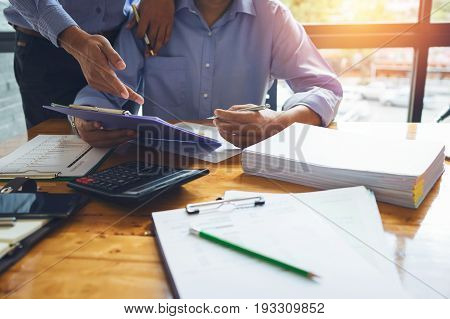 Business Man Accountant Working Hard With Accounting Financial Report Of Annual 2017 With Tax Paperw