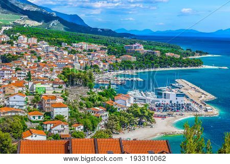 Aerial view on Adriatic Sea and Baska Voda place in Makarska Riviera, Dalmatia region, popular tourist summer resort in Croatia, Mediterranean.