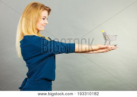 Happy Woman Holding Small Tiny Shopping Cart