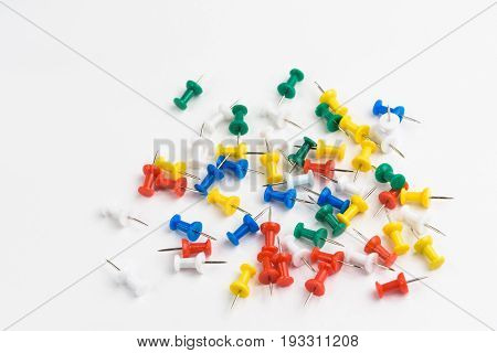 Thumbtacks green yellow blue red white on white background isoloated