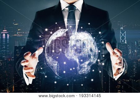 Businessman holding abstract polygonal globe on night city background. Technology concept. Double exposure. 3D Rendering