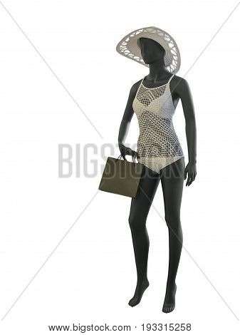Full-length female mannequin wearing fashionable bathing suit isolated on white background. No brand names or copyright objects.