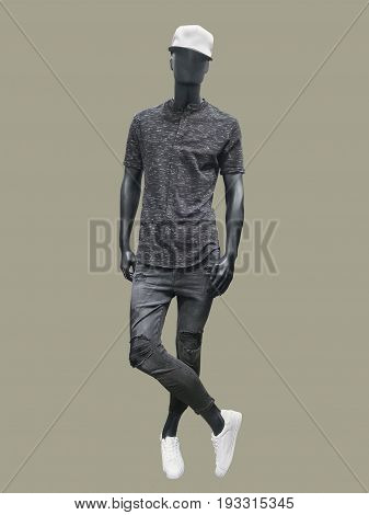 Full-length man mannequin dressed in casual clothes isolated. No brand names or copyright objects.