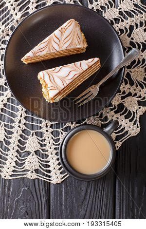 The Cake Of Esterhazy And Coffee With Milk Close-up On The Table. Vertical Top View