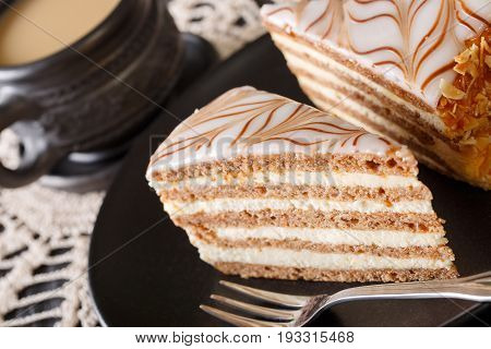 Tasty Hungarian Esterhazy Cake On A Plate And Coffee Close-up. Vertical