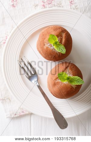 Rumballs Cakes With Mint And Cocoa Powder On A Plate On The Table. Vertical Top View