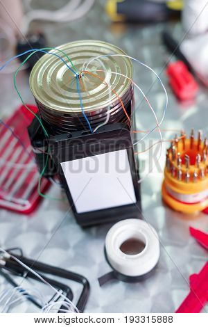 Close up of an improvised homemade bomb explosive device in blurred background.