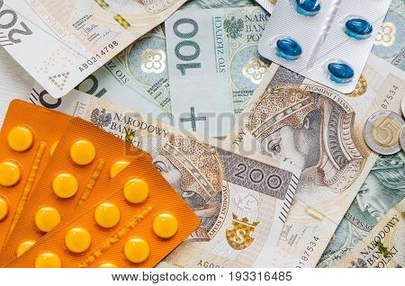 Pills and polish zloty bills. medicine pills health cost polish money zloty pln concept