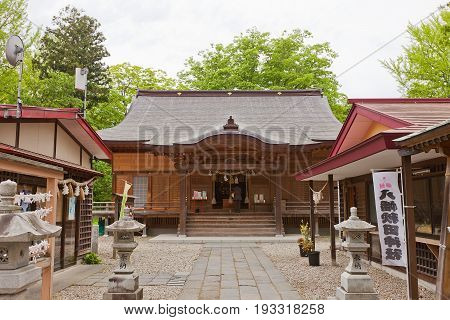 AKITA JAPAN - MAY 26 2017: Haiden Hall (Oratory) of Hachiman Akita Shinto Shrine in Akita Japan. Located on the grounds of former main bailey of Kubota Castle