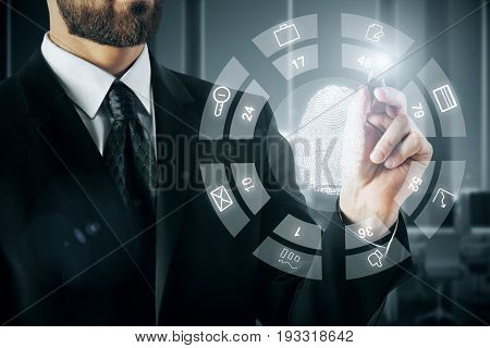 Businessman drawing abstract digital diagram with thumb print in blurry interior. Biometrics concept. 3D Rendering