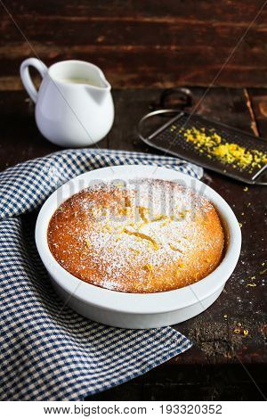 Homemade lemon pudding or souffle in a bowl, selective focus