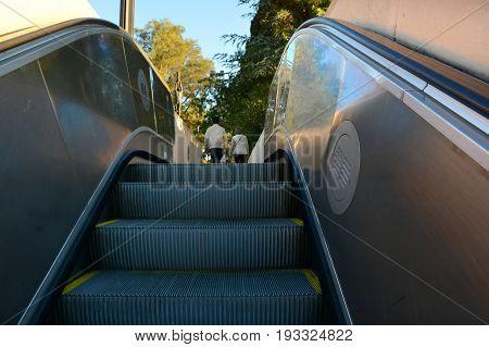 Escalator ladder closeup. Modern technology of movement