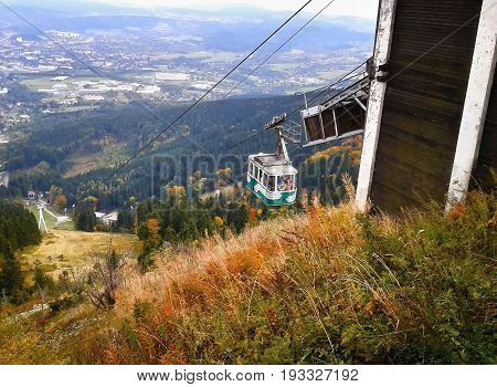 Jested, Czech Republic - October 06, 2012: Green Cabin Of Cableway Moving To Top Named Jested With L