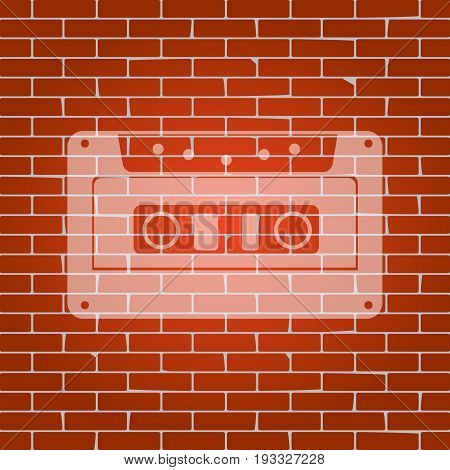 Cassette icon, audio tape sign. Vector. Whitish icon on brick wall as background.