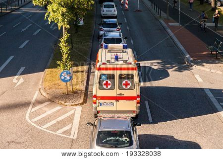 KIEL / GERMANY - JUNE 20 2017: german ambulance car from deutsches rotes Kreuz drives on a street.