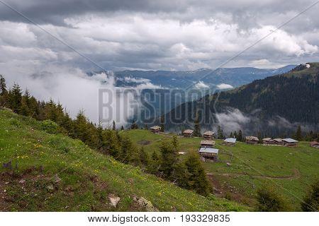 Mountain Village Among Green Pastures
